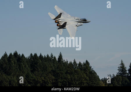 An Oregon Air National Guard F-15 Eagle with the 142nd Fighter Wing, out of Portland, Oregon, flies by the crowd. - Stock Photo