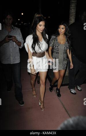 MIAMI BEACH, FL -  MARCH 26: Kim Kardashian looking happy and single. Kim and sister Kourtney Kardashian were joined - Stock Photo