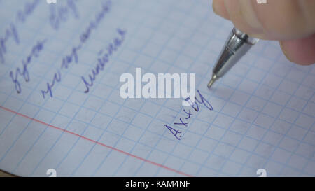Mathematics, Equations close-up. Homework. Solving Mathematical Problem. Student solves the equation on paper - Stock Photo