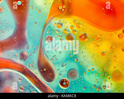 Abstract pattern of coloured oil bubbles on water - Stock Photo