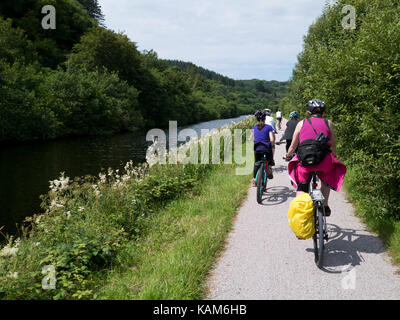 Cycling along the Crinan canal, Argyll - Stock Photo