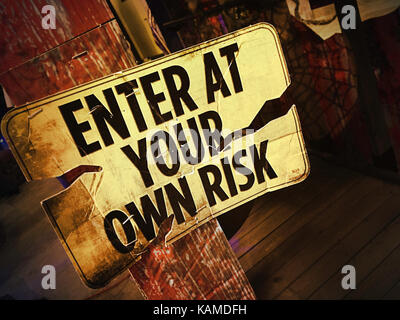 'Enter at Your Own Risk' Sign, USA - Stock Photo