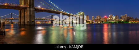 Evening panoramic view of Brooklyn Riverfront with the Manhattan Bridge and the Brooklyn Bridge. Dumbo, Brooklyn, New York City Stock Photo