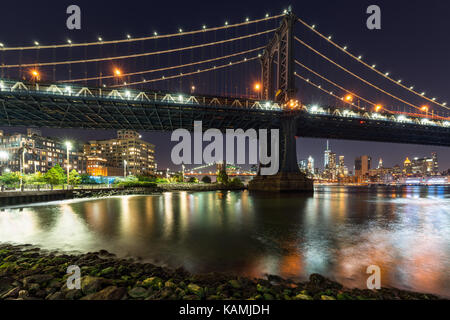 Main Street Park and the Manhattan Bridge at night. Dumbo, Brooklyn, New York City - Stock Photo