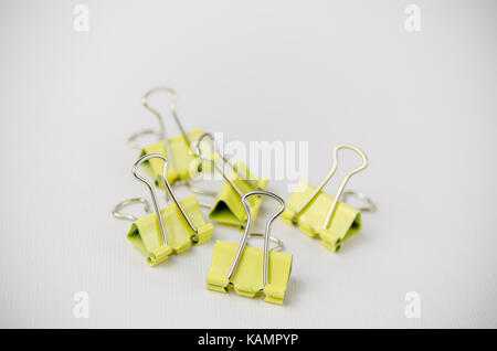 A Studio Photograph of a Group of Yellow Bulldog Clips - Stock Photo
