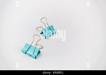 A Studio Photograph of a Pair of Turquoise Bulldog Clips - Stock Photo