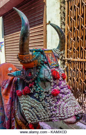 A costumed cow, Holi Festival celebration (Festival of Colors) outside the Banke Bihari Temple, Vrindavan, near - Stock Photo