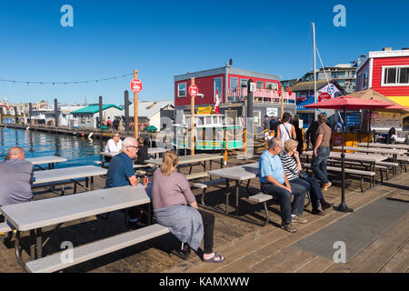 Victoria, British Columbia, Canada - 11 September 2017: People sitting at tables at Victoria Fisherman's Wharf - Stock Photo