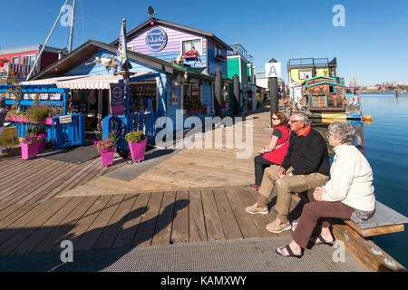 Victoria, British Columbia, Canada - 11 September 2017: People sitting at Victoria Fisherman's Wharf - Stock Photo