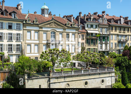 Bern, Switzerland - May 26, 2016: Upscale residential area with gardens near the Bern Cathedral and Aare River. - Stock Photo