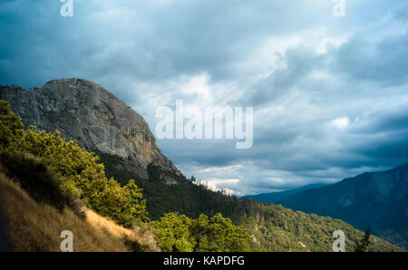 Dramatic landscape with dark clouds featuring Moro Rock, located in Sequoia National Park, California. - Stock Photo