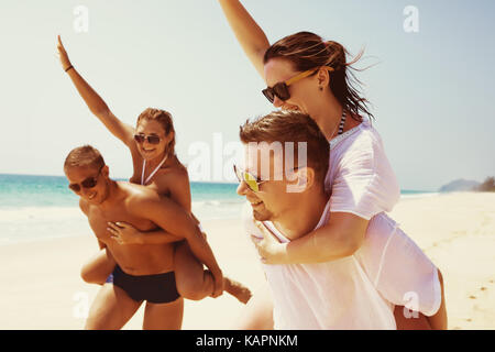 Two couples friends fun beach run - Stock Photo