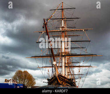 Cutty Sark, historic tea clipper, sailing ship with masts and rigging against a black cloudy sky Greeneich, London, - Stock Photo