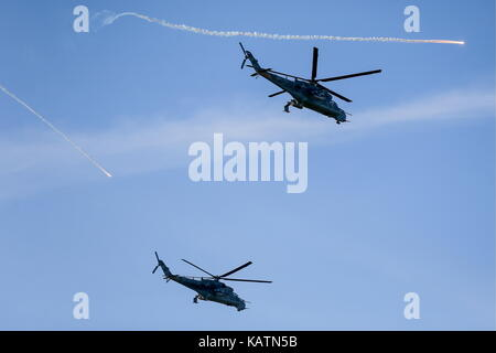 Kaliningrad Region, Russia. 27th Sep, 2017. Mil Mi-24 helicopters in flight during a counter-terrorism simulation - Stock Photo