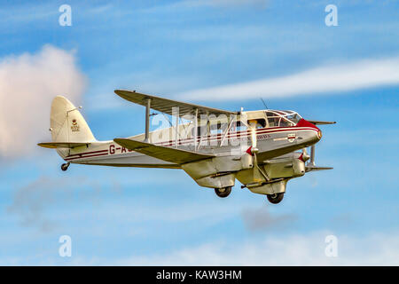 Philip Meeson's 1945 Dragon Rapide 6 G-AGSH, beautifully restored in BEA Livery and named 'Jemma Meeson'. flies - Stock Photo
