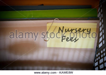 Nursery Fees written on document folder, Dorset, England. - Stock Photo