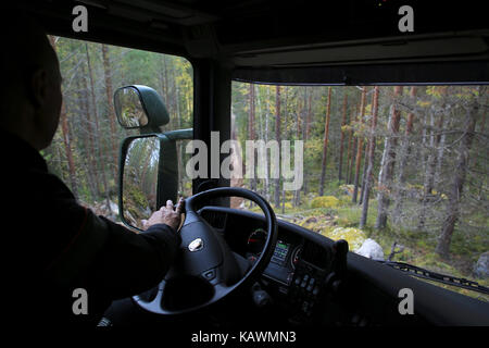 LAUKAA, FINLAND - SEPTEMBER 22, 2017: Looking down from top of the steep hill from the cabin of Scania defense vehicle - Stock Photo
