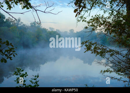 Morning Fog on the autumn river - Stock Photo