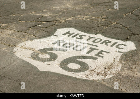 Historic Route 66 sign on tarmac - Stock Photo