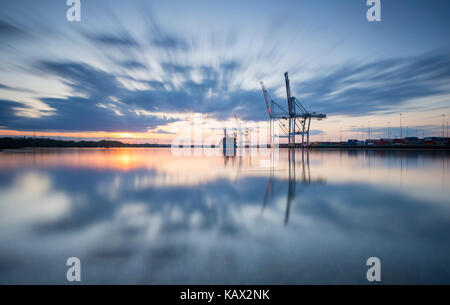 Southampton Docks viewed from Marchwood at sunset. - Stock Photo