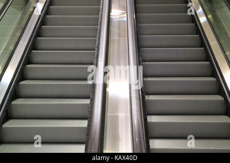 Modern style double escalator staircase in a shopping mall - Stock Photo
