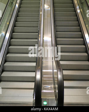Vertical image of modern style double escalator staircase in the shopping mall - Stock Photo