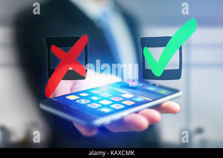 View of Hand drawn red and green tick icon going out a smartphone interface of a businessman at the office - Business - Stock Photo