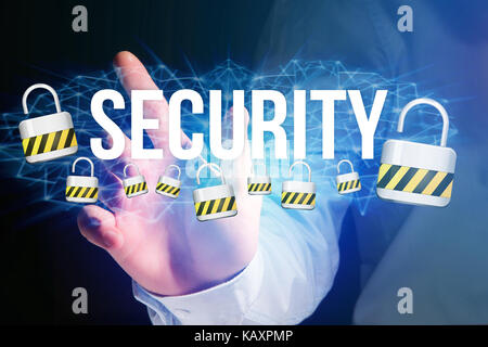 Concept view of man holding interactive interface with security title and multimedia padlock icons flying all around - Stock Photo