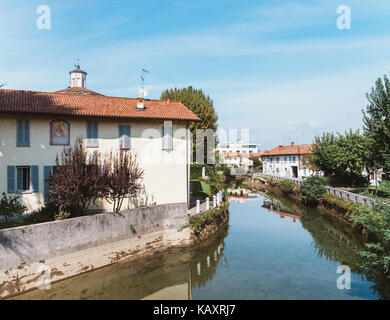 Naviglio Martesana in Lombardy, Italy is a canal from Milan to the River Adda with a cycling lane - Stock Photo