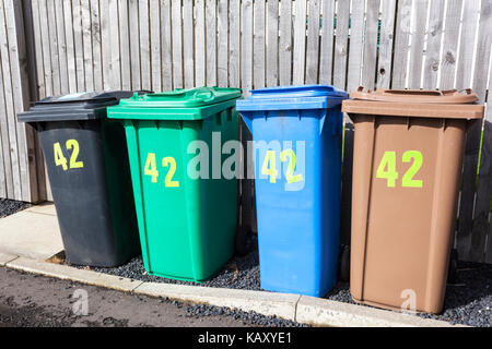 Four full sized recycling wheelie bins for one property at Anstruther, Fife, Scotland UK - Stock Photo