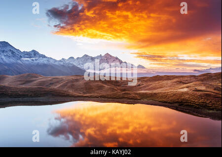 Mountain Lake. Beautiful sunrise. Morning landscape. Koruldi Lake. Main Caucasian ridge - Stock Photo