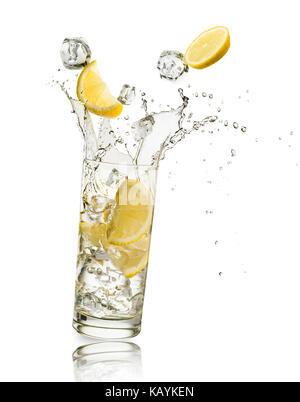 glass full of water with lemon slices and ice cubes falling and splashing water, on white background - Stock Photo