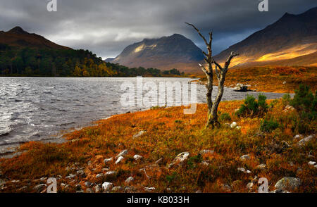 Breaking light over Loch Clair - Stock Photo