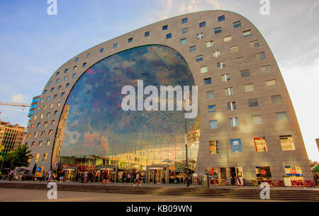 Rotterdam, Netherlands - September 01, 2016: People sprawling at Rotterdam's Indoor Market Hall (Markthal), a covered - Stock Photo
