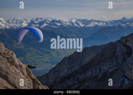 Lucerne Switzerland Luzern Swiss paragliding off Mt Pilatus - Stock Photo