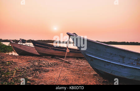 Wonderful landscape of old boats anchored on the margins of Paraguai river in Corumba, Pantanal region in Brazil. - Stock Photo