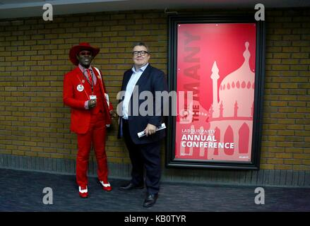 Deputy Labour Party leader Tom Watson with a labour delegate in a smart red suit. - Stock Photo