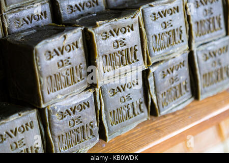 Olive coloured handmade soap bars in Marseille, France - Stock Photo