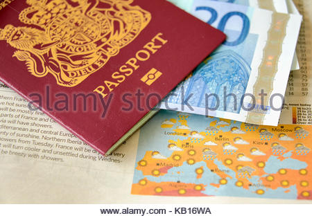 A red european union united kingdom passport with 20 euro banknotes and a map of europe showing sun hotspots - Stock Photo