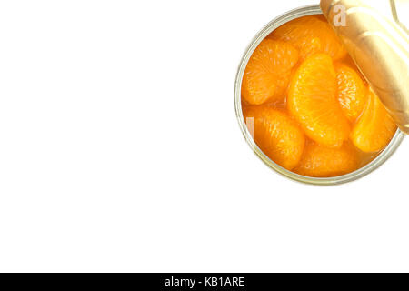 Closeup of an opened can of mandarin oranges on white background with copy space. - Stock Photo