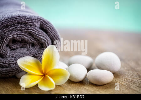White frangipani on towel in the spa, close up - Stock Photo