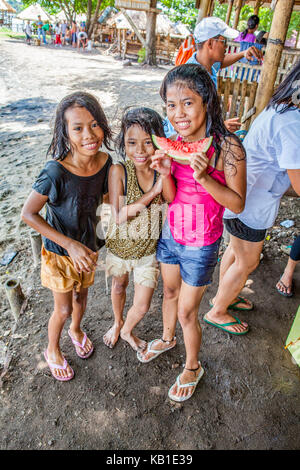 A candid portrait of a young filipino child showing signs of cleft three young filipino girls at the beach eating watermelon in ormoc city leyte island thecheapjerseys Image collections