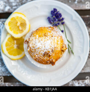 Homemade cupcakes with lemon on a wooden table - Stock Photo
