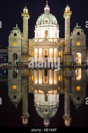 VIENNA, AUSTRIA - AUGUST 30: Tourists at the illuminated Baroque Karlskirche in Vienna, Austria on August 30, 2017. - Stock Photo