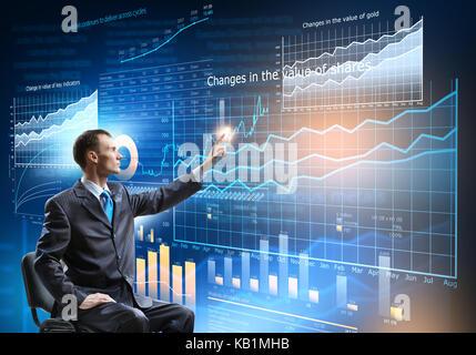 Businessman using media interface - Stock Photo