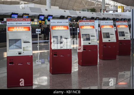 Check in machines at the airport, Hong Kong, - Stock Photo