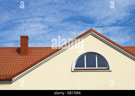 Lithuania, Klaipeda, roof of a house with red clay bricks, gable, window, detail, - Stock Photo
