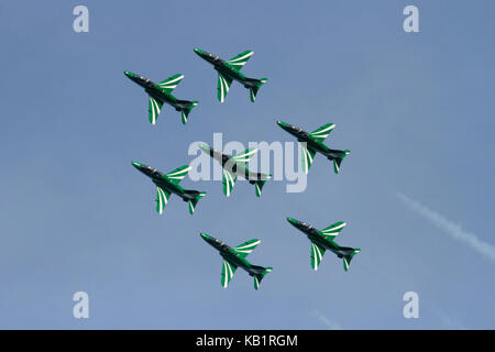 The Saudi Hawks aerobatic display team of the Royal Saudi Air Force flying in diamond formation during an air display - Stock Photo
