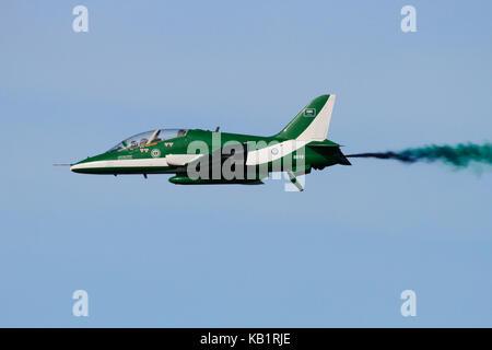 A British Aerospace Hawk Mk. 65 of the Saudi Hawks aerobatic team trailing smoke during an air display - Stock Photo
