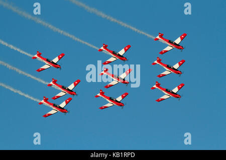 The Swiss Air Force PC-7 aerobatic display team flying in formation during an airshow performance - Stock Photo